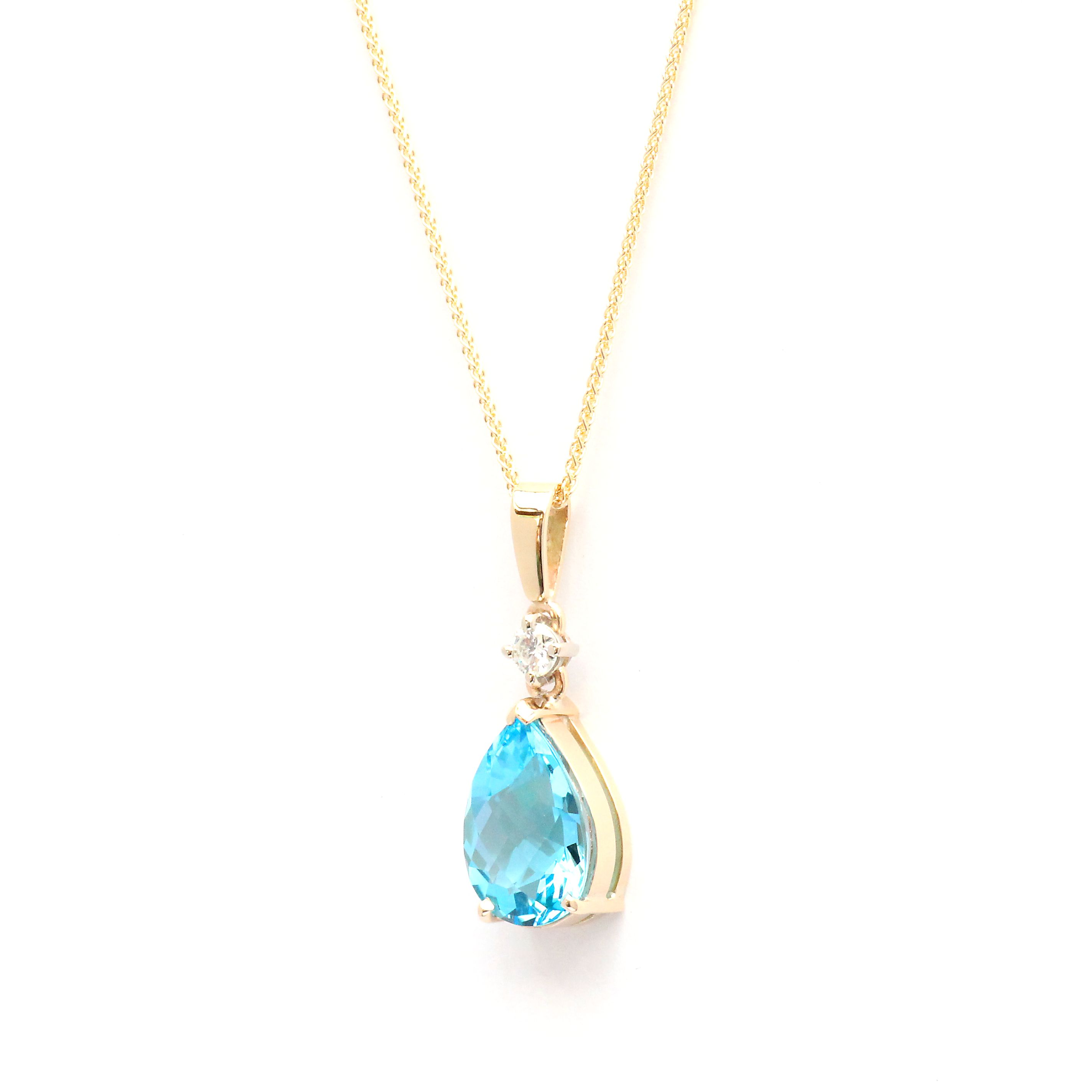 gold and drop white diamond set pear fusion pendant aquamarine